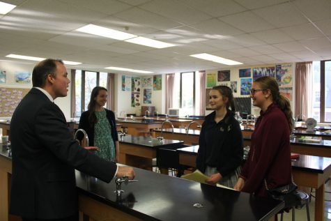 Mr. Lawlor and sophomore, Kaila Timko talk about Biology with visitor