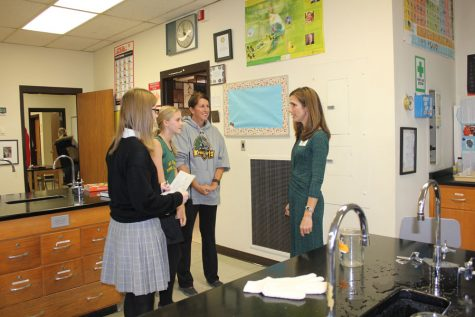 Mrs. Cambell talks to visitors in the Chemistry lab