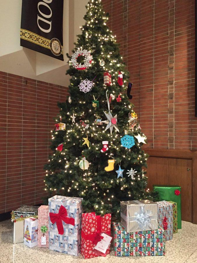 A+picture+of+the+beautiful+finished+Christmas+tree.+It+contains+many+unique+ornaments+created+by+homeroom+representatives.+There+are+also+a+variety+of+different+presents+under+the+tree.