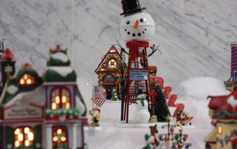 This is the picture of one of the pieces of the train set. It is a picture of a snowman water hydrant.