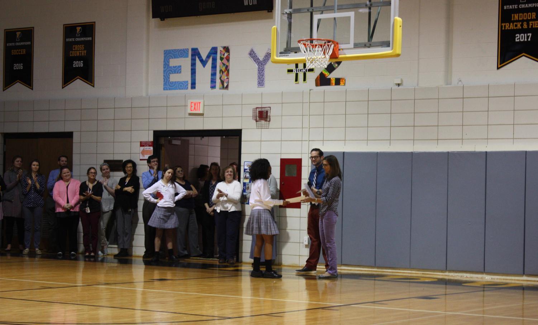 Mr. Sheehan and Mrs. Campbell handing Carter Vaughn her award.