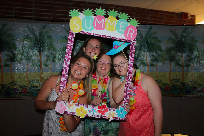 Padua+students+Katelyn+Mcgonigal+and+Kathleen+Melia+pose+for+a+photo+booth+picture+at+the+Blue+Gold+Luau+Prom+2017.