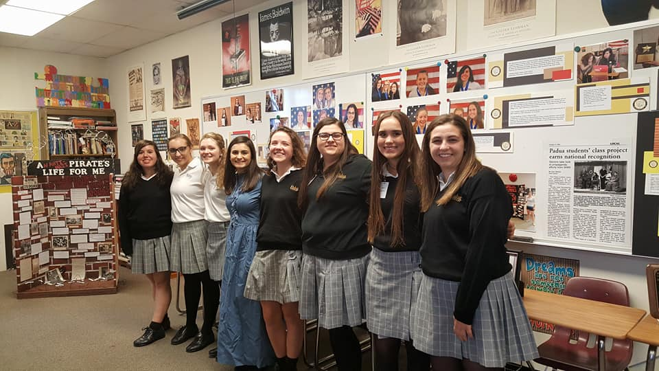 Padua girls wearing the winter uniform on the day of the Open House, from Padua's Facebook