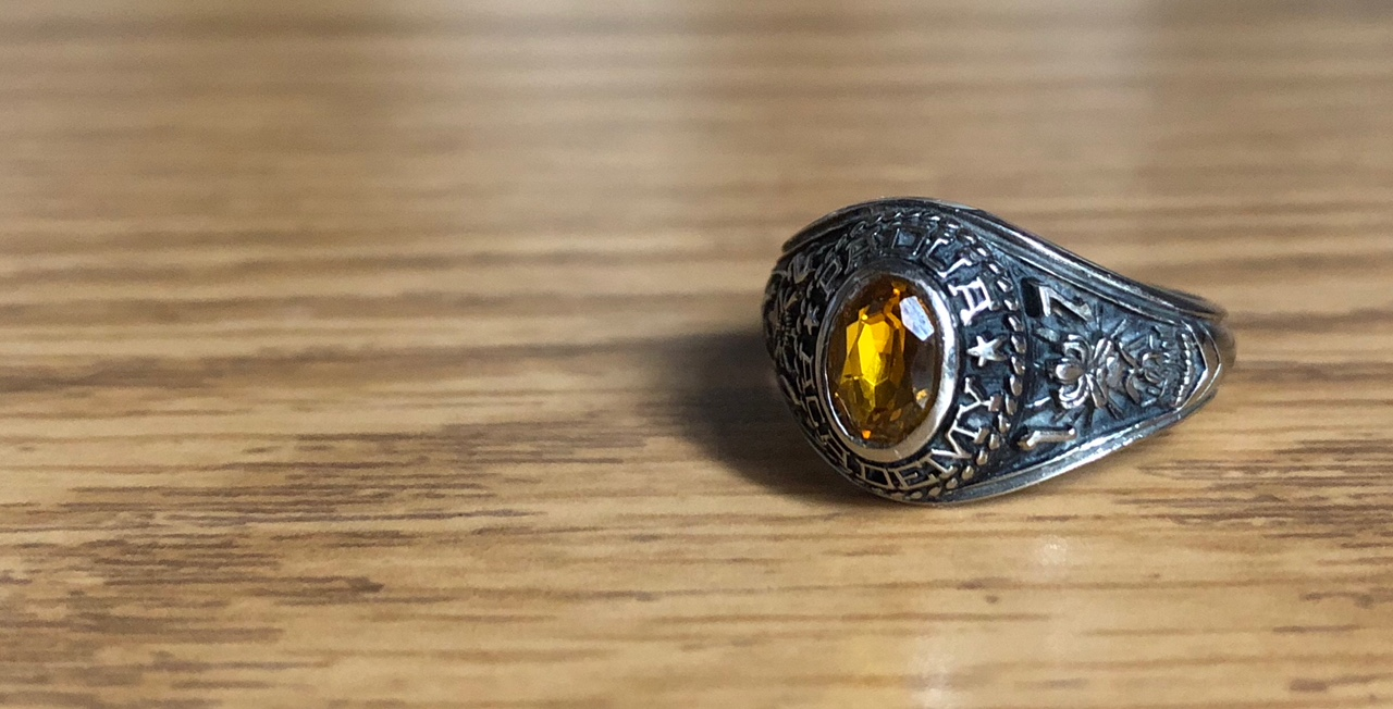 This picture shows Padua Academy's Class of 2017 Ring from Jostens. If you look at the picture from a zoomed in angle, the numbers 1 and 7 are represented on the right next to the emblem for the graduating year.
