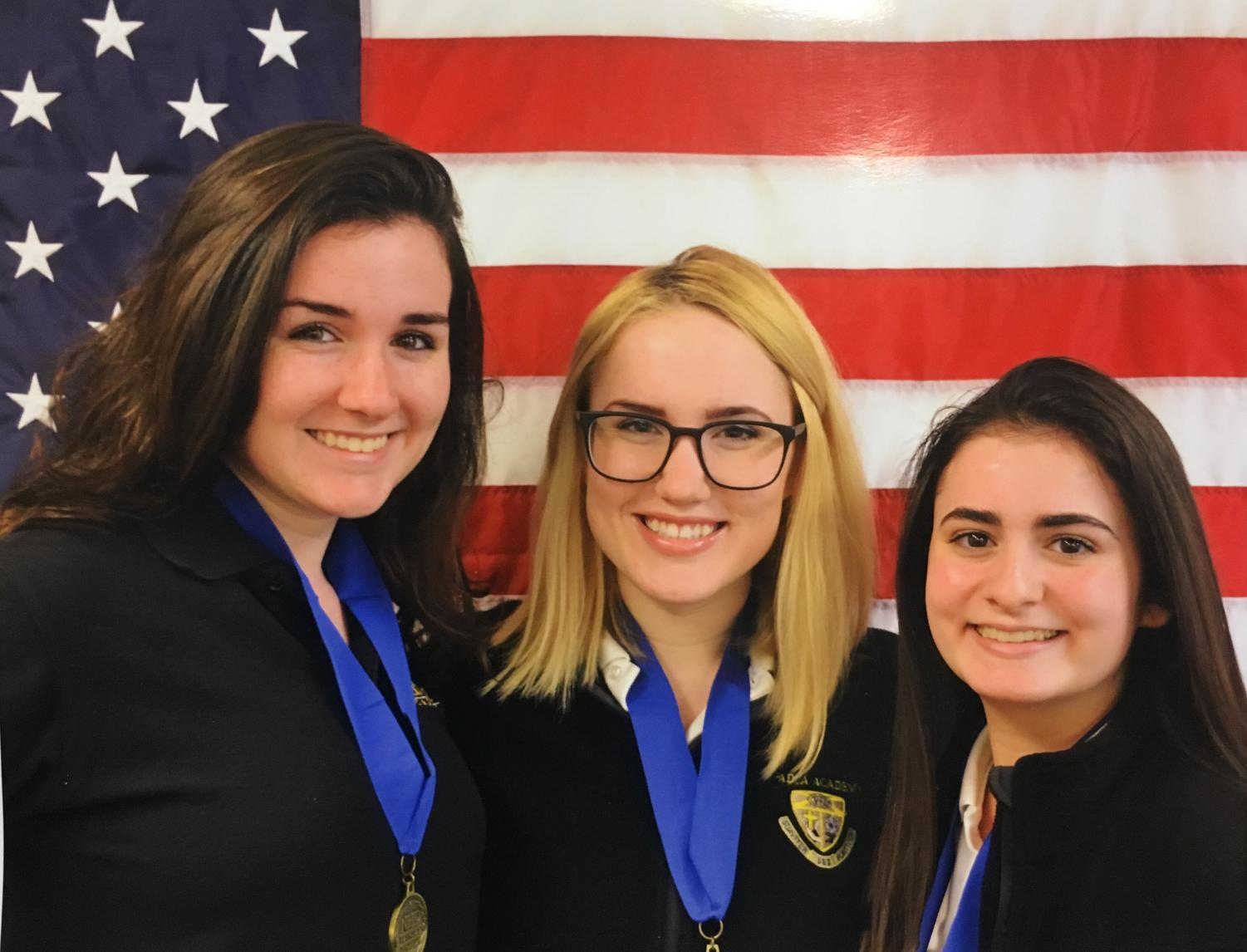 Natalie Onesi, Chrissy Molloy, and Sara Mayberry pose for a photo after they receive their first place medals.
