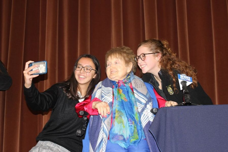 Eva Kor takes a picture with seniors Lauren Mottel and Sarah Jane Mee. Kor visited Padua on Nov. 19, 2018.