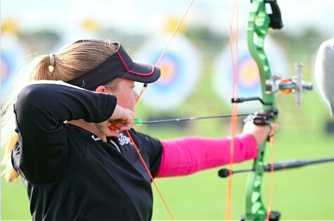 Katie Collier, sophomore, shoots an arrow during a tournament.