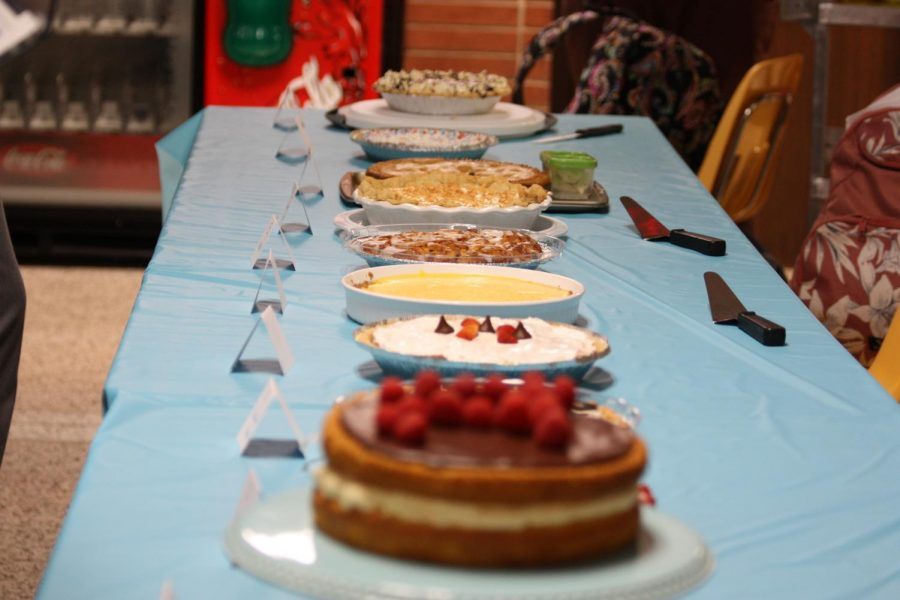 All of the pies made by students are set up for the students to taste.