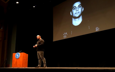 Picciolini shows a picture from his time in the skinhead movement. He has since reconciled with many of those he harmed, and helped many others to leave the movement.