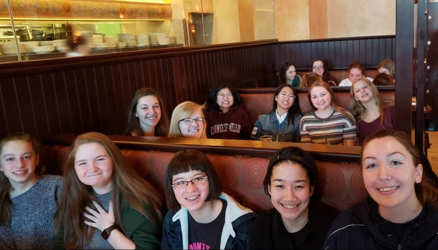 Team+members+smile+during+their+celebratory+dinner+at+the+Cheesecake+Factory.