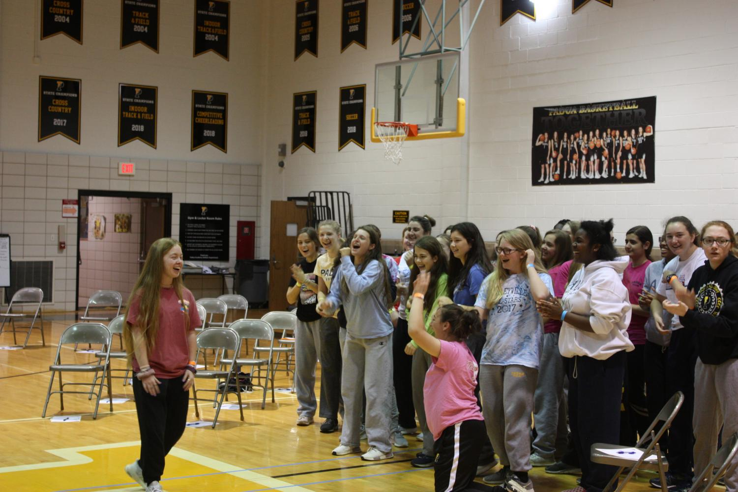 The freshmen participating in one of the BRAVE activities in which they had to cheer their fellow freshman on.