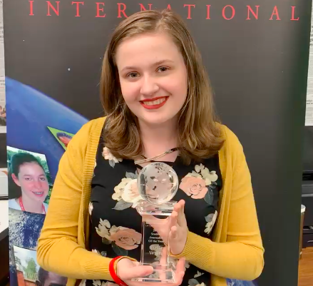 Stella White poses with her Student Journalist of the Year award, presented by Youth Journalism International.