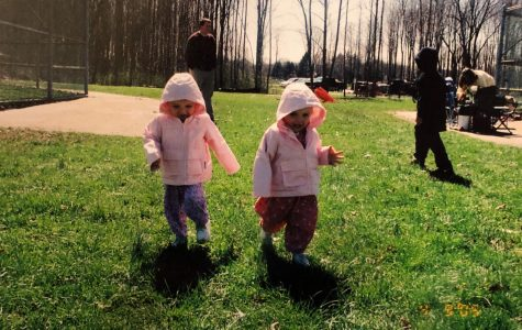 Meghan and Madison Wilhelm at the park as children. As kids, their parents used to dress them alike, as evident in their matching coats.