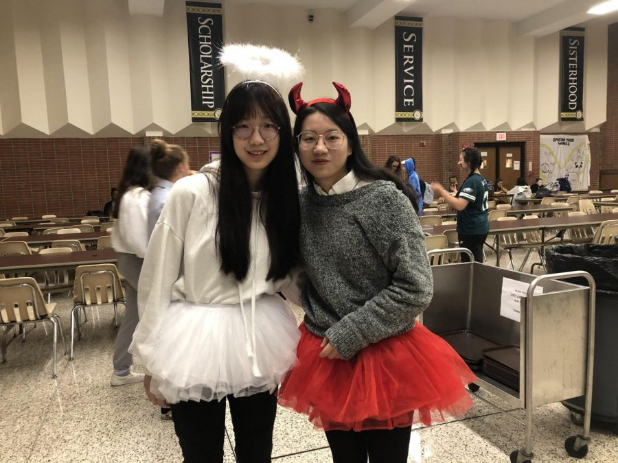 Seniors+Crystal+Zheng+and+Elizabeth+Lin+dressed+up+as+an+angel+and+devil.+Angels+and+devils+have+always+been+popular+options+for+costumes.%0A