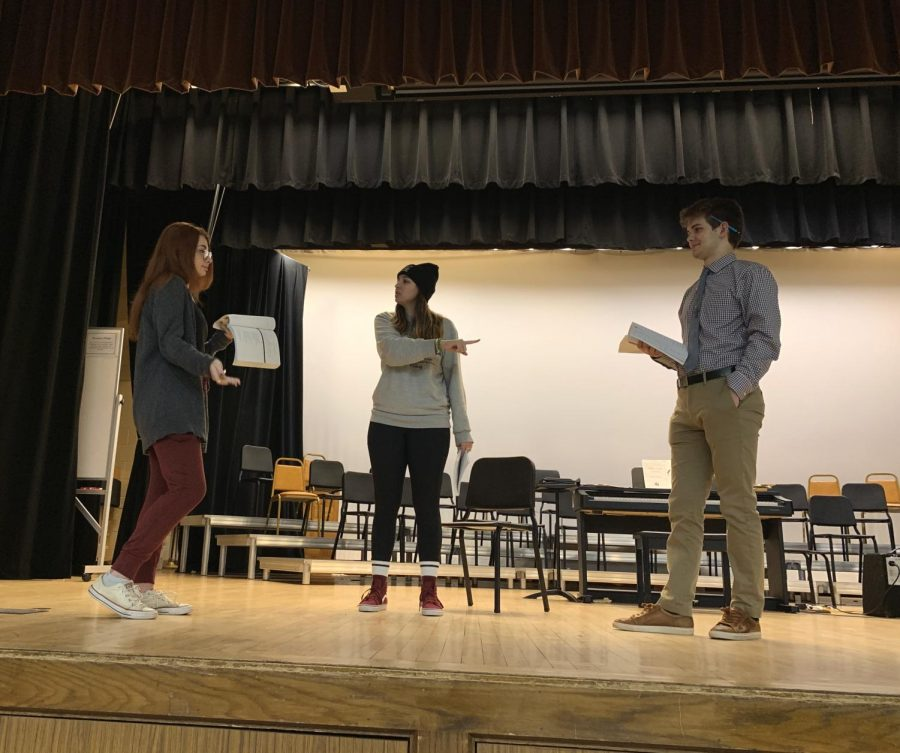 Student producer Caroline Achenbach, director Meg Jullian, and Salesanium student Jack Krukiel adjusting lines during rehearsal.