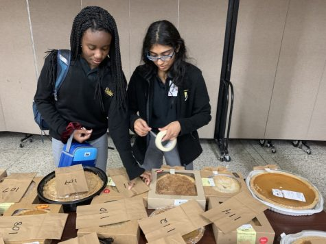 The Blue-Gold committee at Padua worked really hard for this event to be as successful as it was. The members were the ones who brought in the pies and the ones who got the pies ready for auction. In this picture, you can see some members hanging up the bags for the tickets.
