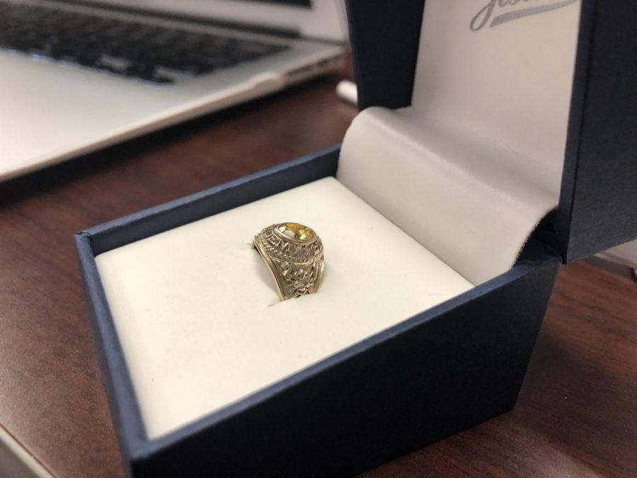 The rings from Jostens came in different sizes, colors, and embellishments. This particular ring is gold, but like the other class rings it include a yellow gemstone.