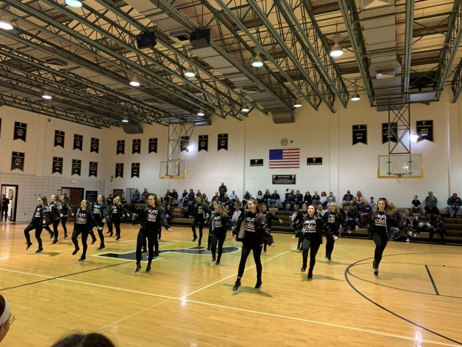 The+dance+team+performing+at+halftime+during+a+Padua+basketball+game.