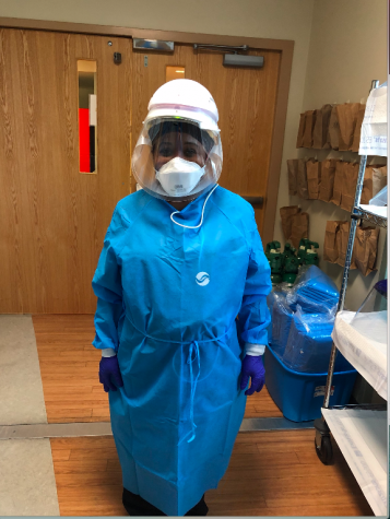 Elizabeth Musa wearing the protective gear required at her hospital. She wears this gear and mask her entire twelve hour shift to protect herself from exposure to COVID-19.