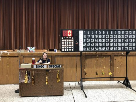 Mrs. Pugliese running the bingo at Blue Gold Bingo Night.