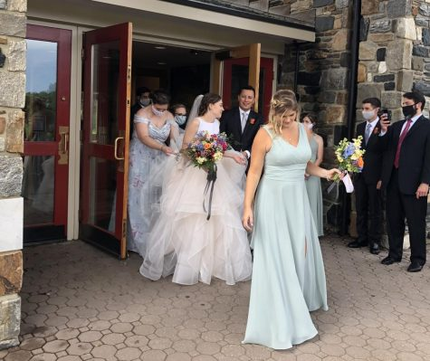 The Morenos leave St. Cornelius Catholic Church in PA on their wedding day with their wedding party.