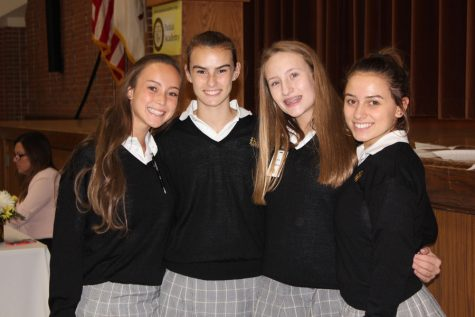 Madeline Williams '19, Maria Rivell '19, Erin Desmond '19, and Mia Iannucci '19 posing for a picture