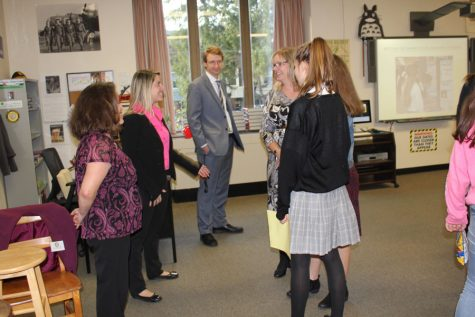 Dr. Hall, Mrs. Pugliese, and Mr. Mahler give information to visitors