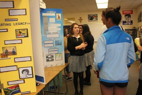 Camila Moreno '17 talks to guest about her History Day project