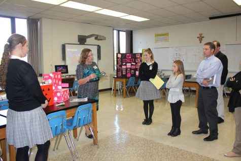 Mrs. Szurkowski explains an engineering project to guests