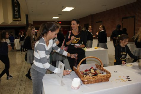 Visitors enjoy the food Padua provided at Open House