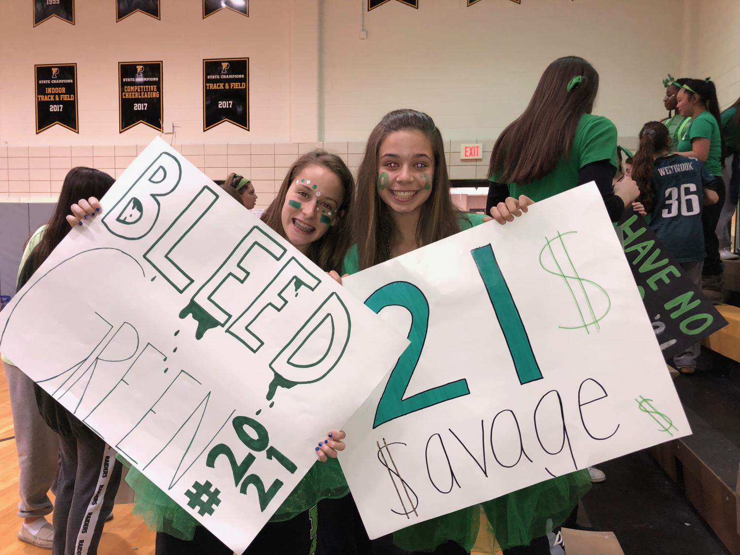 Erin Callaghan (left) celebrating the color wars day in green.
