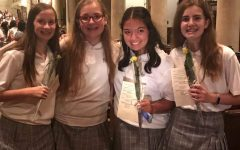Freshmen showing their rosebuds from Convocation.