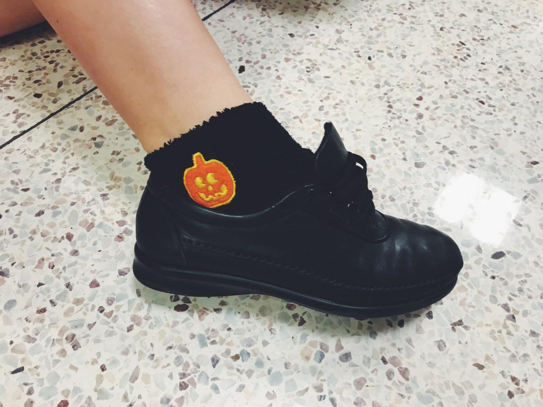 Frankie's hidden pumpkin socks.