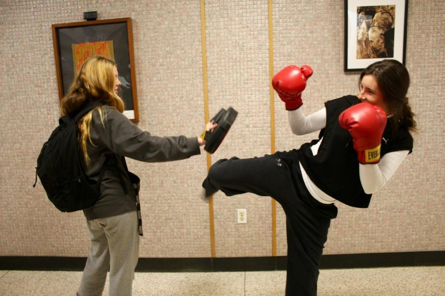 Amanda Patterson (right) channeling her costume as a boxer!