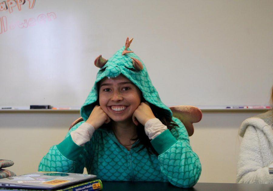 Emma Gruskiewicz all cozy in her dragon onsie.