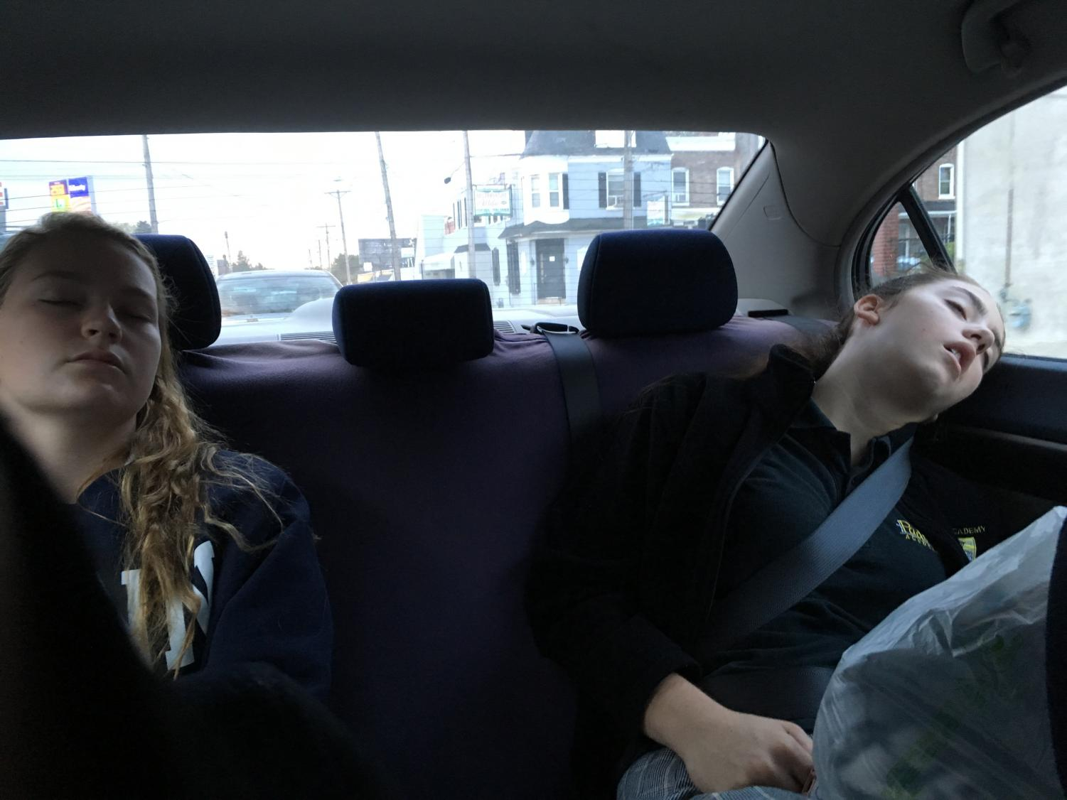 Juniors Tess Lunetta and Jess Molen sleep on the way to school. Many students find an early start to the day difficult after minimal sleep.