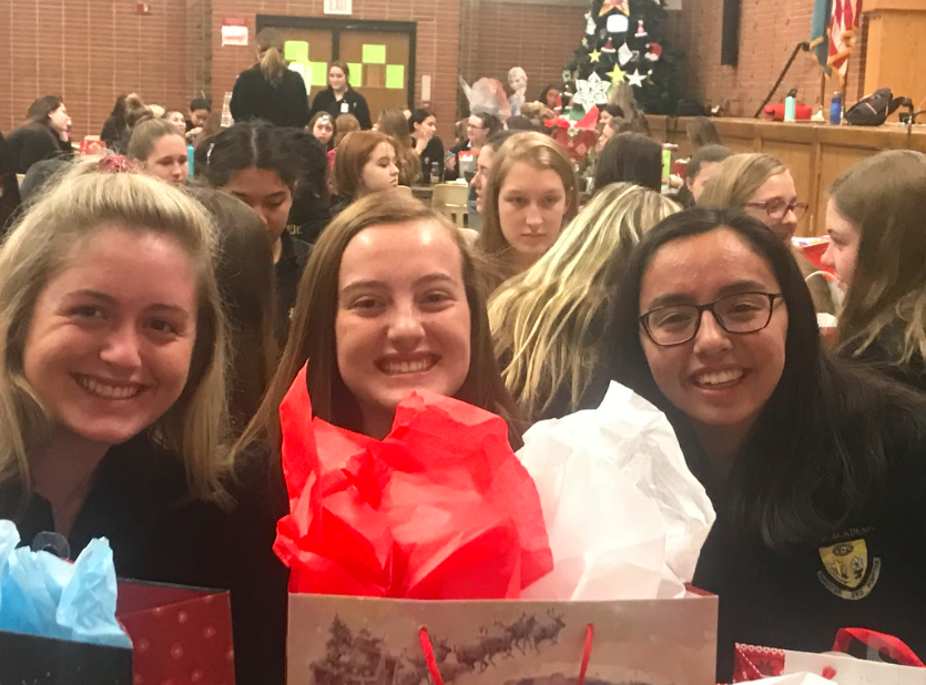 Hannah+Mannering+and+Lauren+Mottel%2C+seniors%2C+sit+with+their+little+sister%2C+Alexis+Rabinovitch+during+the+gift+auction.