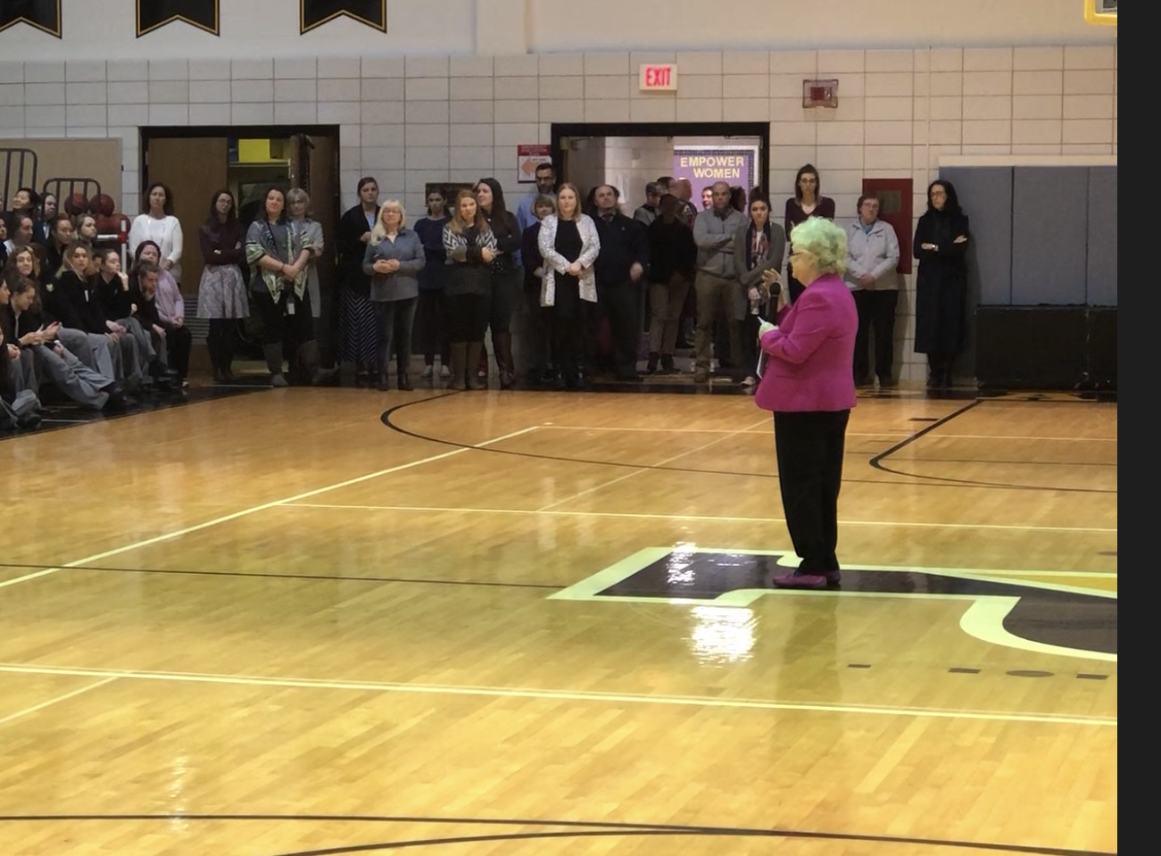 Principal Cindy Mann announces her retirement at Community Homeroom.