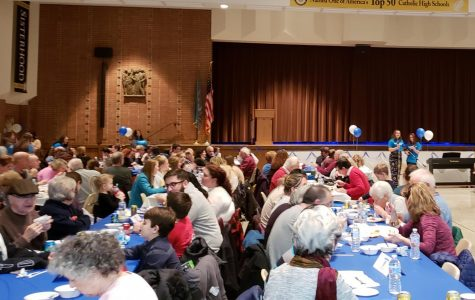 Dinner attendees enjoy their spaghetti and the musical entertainment. The event was emceed by junior Moira Gervay and senior Rose Langrehr.