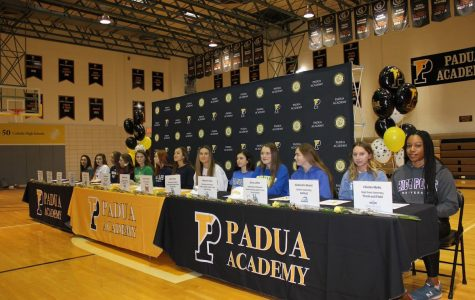 Thirteen of Padua's senior athletes at the signing day ceremony