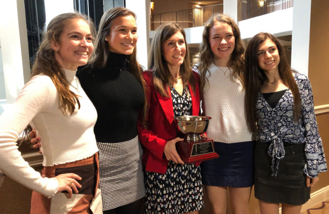 Marnie+Giunta+with+her+athletes+after+getting+her+award