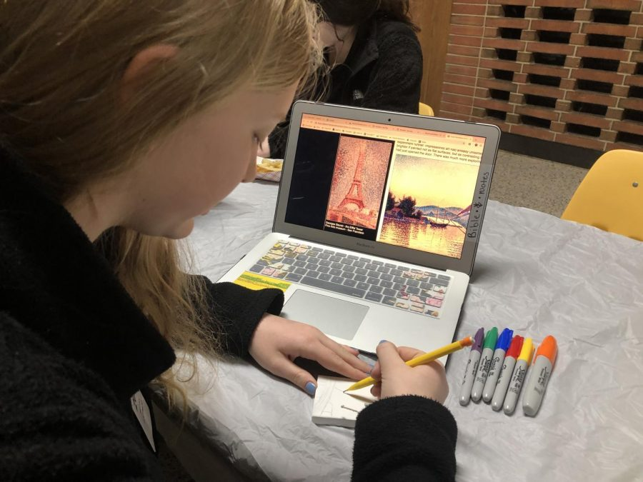 Megan Boehmler picks the picture she wants and then begins to sketch.