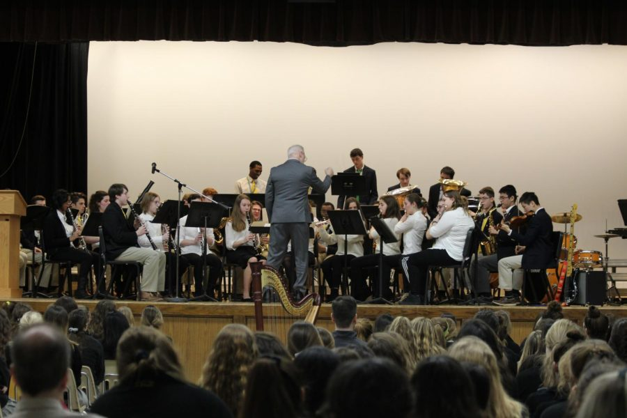 The+Wind+Ensemble+performing+a+song+conducted+by+Mr.+Cox.+