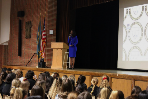 Immaculée Ilibagiza addresses students, discussing her story of survival, finding God, and forgiveness. She spoke to students and teachers on April 10, 2019.