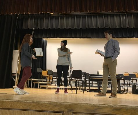 Student producer Caroline Achenbach, director Meg Jullian, and Salesanium student Jack Krukiel adjusting lines during rehearsal.
