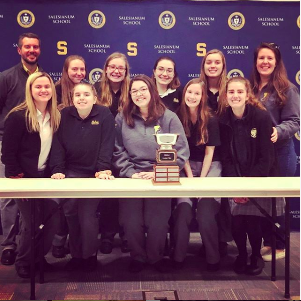 The Academic Bowl Team smiled for a picture at the competition, and consisted of Heather Banas, Abby Freebery, Annie McTaggart, Grace Donaher, Emily Malone, Gina Rufo, Caitlin Kennedy, Meredith Kuchma, and Geneva Laur. The team achieved a score of 175 to 170.