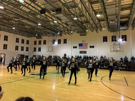 The dance team performing at halftime during a Padua basketball game.
