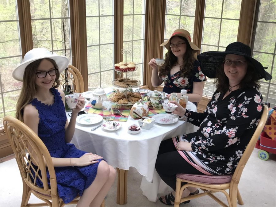 My family organized an elaborate tea party. In this photo, you can see our fancy table setting, outfits, and treats.