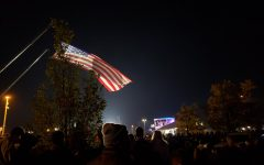 An American flag waves through the air during the Biden-Harris victory celebration. Supporters flocked to the Riverfront on November 7 to be part of the historic night.