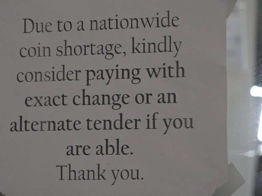 This sign located at ACME alerts customers about the coin shortage.